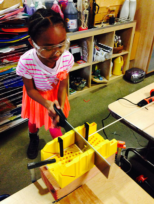 Preschool Student Works Safely with a Saw