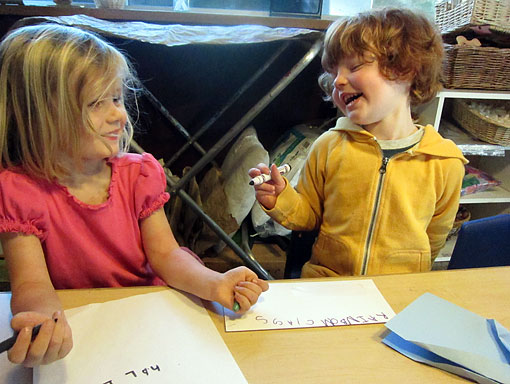 Two Preschool Students Draw Together
