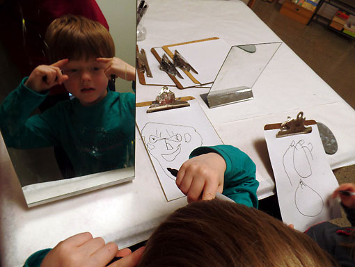 Elementary Student Draws Self-Portrait