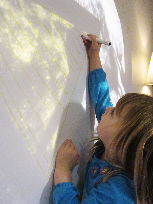 Preschool Student Draws a Poster