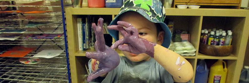 Preschool Student Fingerpaints.