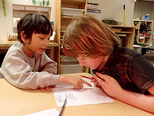 Two Elementary Kids Help Each Other with Homework